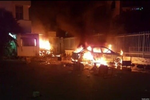 A car is ablaze in the Palestinian-majority town of Kafr Qasim in central Israel after Israeli forces shoot and kill 20-year-old Ahmed Mahmoud Taha on 6 June 2017 [Israeli police]