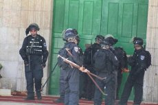 Israeli forces stormed into Al-Aqsa Mosque and fired tear gas at worshippers on 19 June 2017 [Abbs Winston/Twitter]