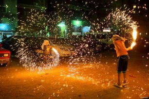 CAIRO, EGYPT- Kids, don't try this at home! Boys play with sparklers as they welcome the month of Ramadan