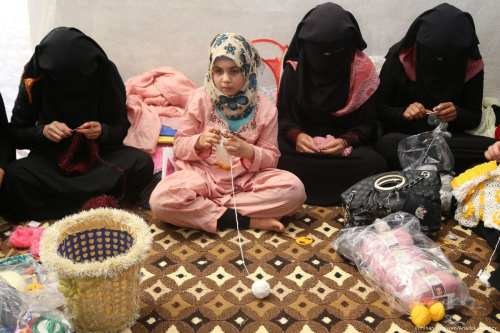 Syrian girls crochet inside their tent in preparation for Eid during Muslim's holy month of Ramadan in Idlib, Syria on 23 June 2017 [İsmihan Özgüven/Anadolu Agency]