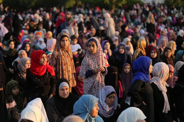 Palestinian Muslim women perform Eid al-Fitr prayers in Gaza City June 25, 2017. Eid al-Fitr marks the end of Muslim's holy fasting month of Ramadan when faithfuls abstain from eating, drinking, smoking and sexual activities from dawn to dusk. Photo by Ashraf Amra