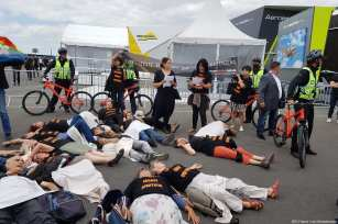 French BDS activists along with members of the collective Les Désobeissants seen staging a non-violent protest action against the Israeli defence company Elbit Systems at the Paris Air Show on June 24, 2017 [BDS France / Les Désobeissants]