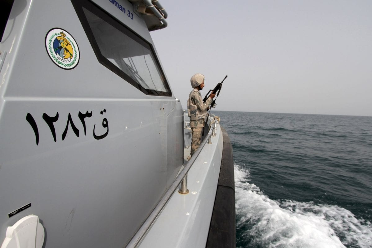 A Saudi border guard watches as he stands in a boat off the coast of the Red Sea on Saudi Arabia's maritime border with Yemen, near Jizan April 8, 2015 [Faisal Al Nasser / Reuters]