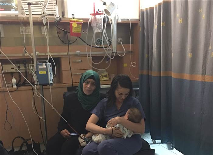 Israeli nurse Ola Ostrowski-Zak breastfed a Palestinian baby after a car accident left his mother unconscious [Hadassah Kerem Medical Centre]