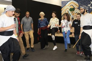 Ticket holders are taught how to do dabke, a traditional Palestinian dance in one of the workshops held throughout the day at the Palestine Expo. [Image: Jehan Al-Farra / Middle East Monitor]