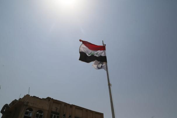 The Iraqi flag is seen in Mosul after the city was freed from Daesh 9 July 2017 [Yunus Keleş/Anadolu Agency]