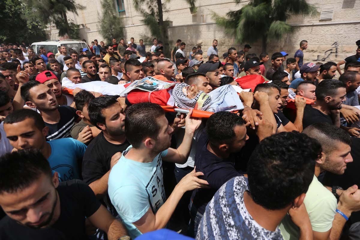 Palestinians carry the dead bodies of 15 year old Palestinian Aws Salame and 20 year old Saad Salah, who were killed by Israeli forces during a raid to Jenin Refugee Camp, in Jenin, West Bank on 12 July, 2017 [Issam Rimawi/Anadolu Agency]