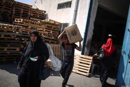 Humanitarian aid sent by Disaster and Emergency Management Presidency of Turkey (AFAD) and Turkish Cooperation and Coordination Agency (TIKA) are being distributed in Gaza City, Gaza on July 16, 2017 [Ali Jadallah / Anadolu Agency]