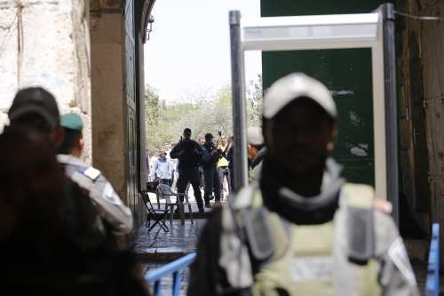 Palestinians gather in front of the new security metal detectors, outside one of the main entrances to the Al-Aqsa mosque, refusing to enter because of the detectors installed by Israel as the holy site re-opened for the first time on Sunday since a two-day closure following a deadly shootout in Jerusalem on 18 July, 2017 [Mostafa Alkharouf/Anadolu Agency]