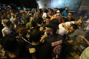 Israeli security forces intervene the Palestinians after they performed night prayer as they refusing to enter because of the detectors installed by Israel outside of the main entrances to the Al-Aqsa mosque that re-opened for the first time on Sunday since a two-day closure following a deadly shootout in Jerusalem on July 18, 2017. Some protesters along with Al-Aqsa Mosque Ikrimah Sabri wounded during the intervention. ( Mostafa Alkharouf - Anadolu Agency )