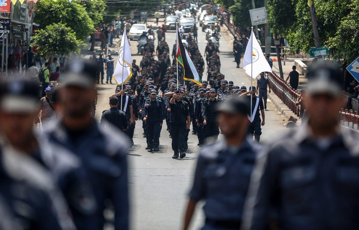 Palestinian soldiers march from Al-Saraya Square to Legislative Assembly on 26 July 2017 [Ali Jadallah/Anadolu Agency]