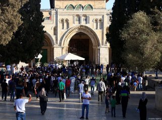 JERUSALEM - JULY 28 : Palestinians gather to celebrate near Jerusalem's Old City as they enter the Al Aqsa Mosque following the removal of Israel's restrictions at the entrances to Al Aqsa Mosque in Jerusalem on July 28, 2017. ( Enes Canlı - Anadolu Agency )