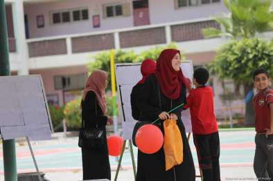Students in Gaza celebrate after receiving their exam results. Students across Palestinian achieve higher pass marks in 2017 than in previous years [Mohammed Asad/Middle East Monitor]