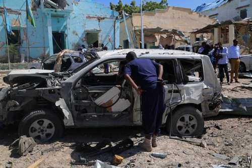 Vehicles and buildings in ruin after a bomb exploded in Mogadishu, Somalia on 20 June 2017 [Sadak Mohamed/Anadolu Agency]