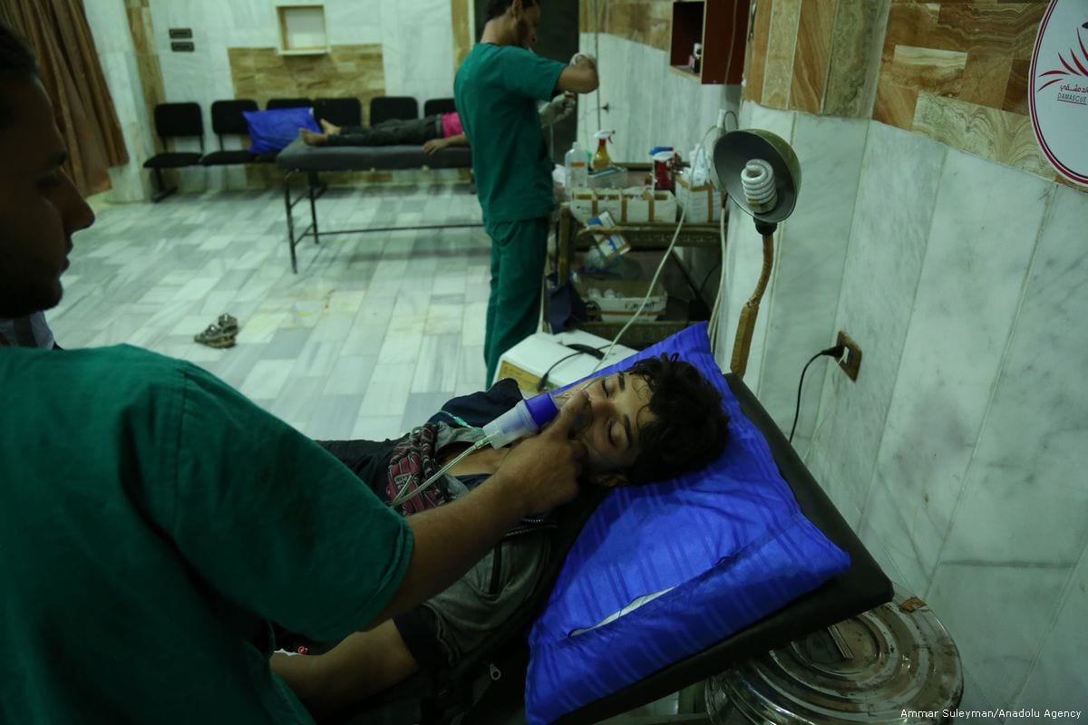 Syrians receive medical treatment after Assad regime carried out chemical gas attack in Damascus, Syria on 13 July 2017 [Ammar Suleyman/Anadolu Agency]