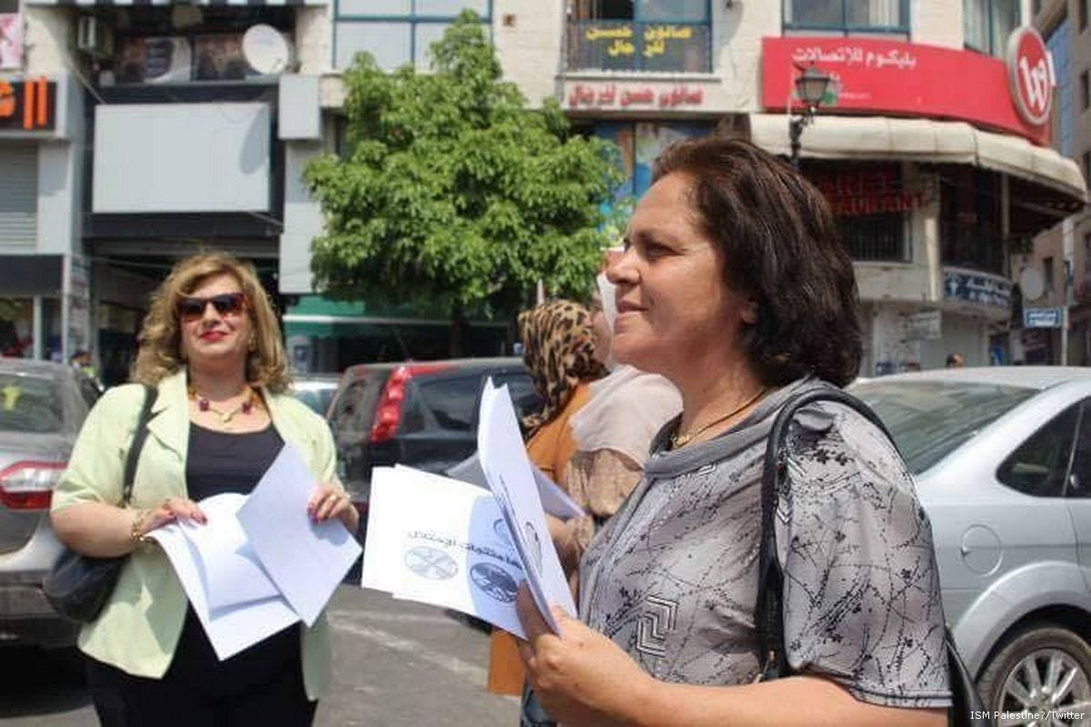 Image of Khitam Al-Saafin (L) head of the Union of Palestinian Women's Committees [ISM Palestine‏/Twitter]