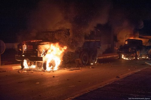 Vehicles on fire during a protest demanding the release of detainees in Al Hoceima, Morocco on 21 July 2017 [Jalal Morchidi/Anadolu Agency]