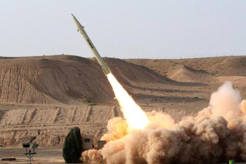 An upgraded version of the short-range surface-to-surface Fateh-110 missile is test fired in 2010 in this photo released by the Iranian Defense Ministry [Vahid Reza Alaei / Iranian Defense Ministry]