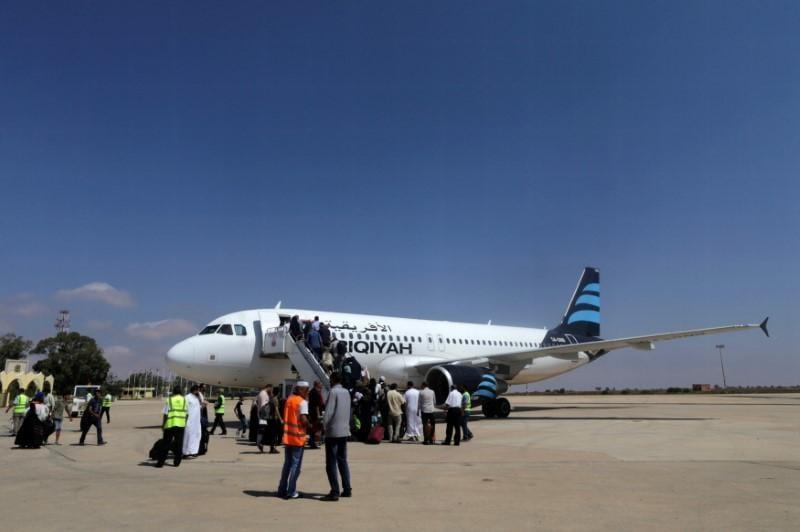 Passengers board a flight at Benina airport east of Benghazi, Libya, July 15, 2017 [Esam Omran Al-Fetori / Reuters]