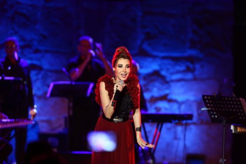 Lebanese singer Nancy Ajram performs during the 53rd International Carthage Festival at The Carthage Amphitheater on 10 August 2017 in Carthage, Tunisia [Yassine Gaidi/Anadolu Agency]