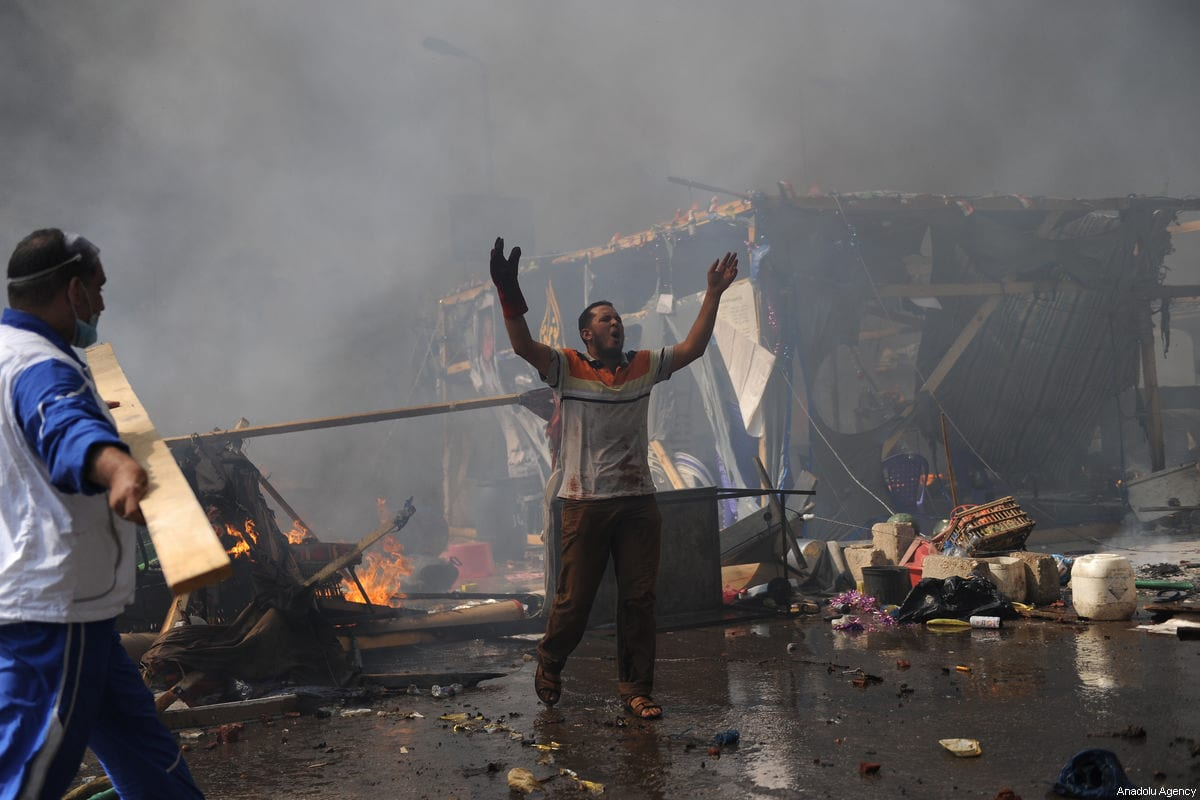 A file photo dated August 14, 2013 shows a supporter of Mohammed Morsi shouting as Egyptian security forces stormed the Rabaa Adawiyya sit-in in Cairo, Egypt. ( Mohammed Elshamy - Anadolu Agency )