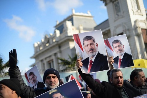 A file photo dated January 24, 2016 shows Egyptians holding portraits of deposed President Mohammed Morsi, who was overthrown in a military coup lead by Abdul Fatah Al-Sisi, now President, next to Consulate General of Egypt in Bebek district of Istanbul, Turkey. ( Mohammed Elshamy - Anadolu Agency )