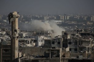 A destroyed minaret is seen as smoke rises after Assad regime forces' carried out an air strike at the Ein Terma town of Eastern Ghouta, which is a de-conflict zone under control of opposition forces, in Damascus, Syria on August 17, 2017. ( Ammar Süleyman - Anadolu Agency )