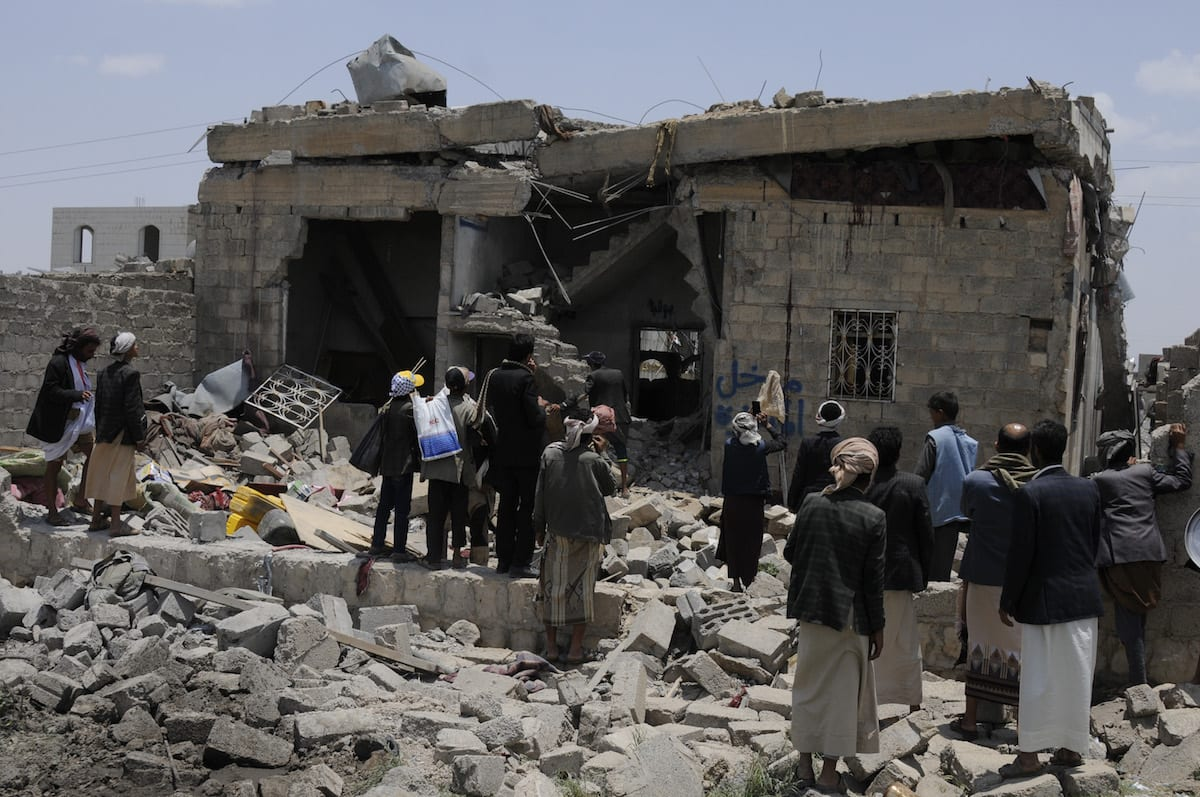 People search for survivors after airstrikes carried by the Saudi-led coalition over Arhab District of Sanaa, Yemen on 23 August 2017 [Mohammed Hamoud/Anadolu Agency]