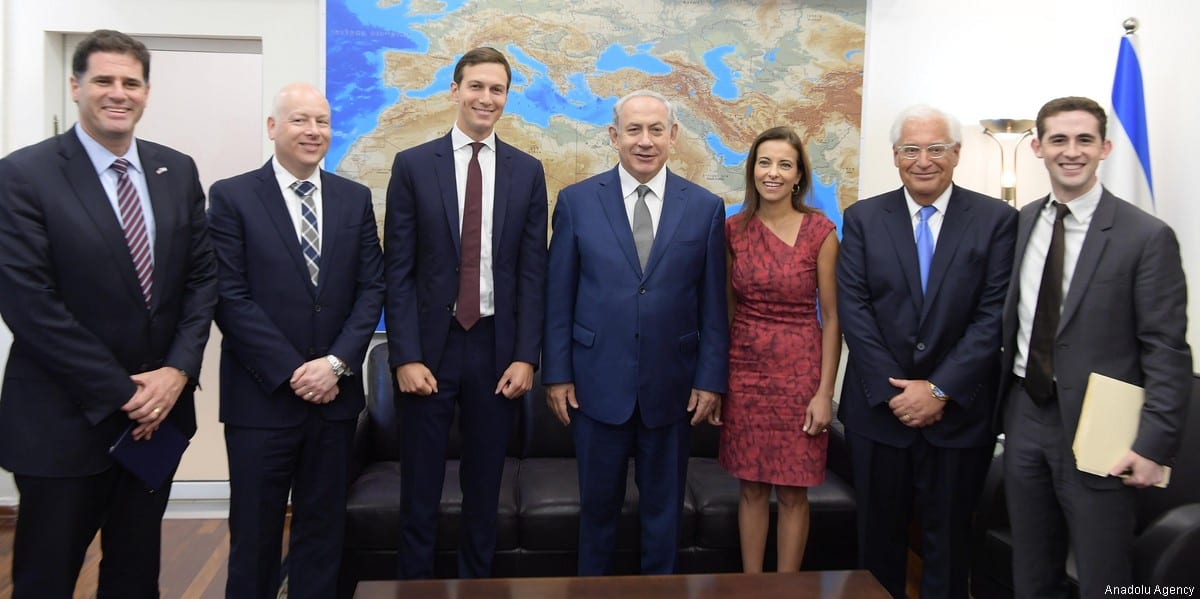 Jared Kushner (3rd L), US President Donald Trump's son-in-law and adviser, along with his delegation, pose with Israeli Prime Minister Benjamin Netanyahu (4th R) prior to their meeting in occupied East Jerusalem, on 24 August 2017. [Israeli Prime Ministry /Handout]