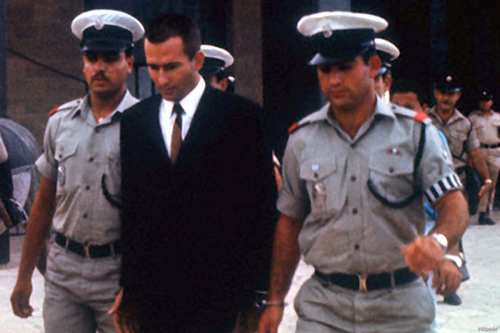 Heavily guarded by police, Australian born Denis Michael Rohan leaves court where he is on trial accused of setting fire to the Ancient Al-Aqsa Mosque on 21 August, 1969 [Bettmann, CORBIS/Wikipedia]