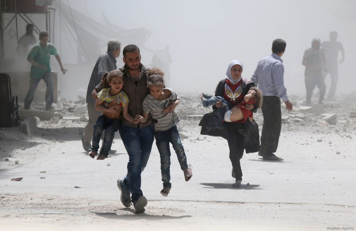 Civilians escape from explosion site after Assad Regime's forces strike over the de-conflict zone, Ein Tarma Town of Eastern Ghouta region of Damascus, Syria on 22 August, 2017 [Alaa Mohammad/Anadolu Agency]