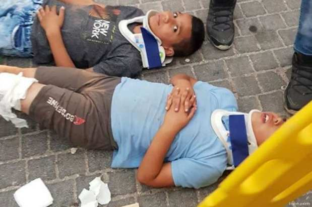 Wounded Palestinian children are seen after an Israeli settler deliberately ran over them on 10 August 2017 [English.palinfo]