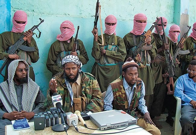 Mukhtar Robow Abu Mansur (centre) seen during a Al-Shabaab press conference during his time as the group's spokesperson