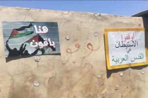 Posters are placed outside the Shamasna home in the Sheikh Jarrah neighbourhood of occupied East Jerusalem. The family faces imminent eviction to make room for Israeli settlers who claim they own the property. The posters read 'Here we will remain' and 'Stop the occupation of Arab Jerusalem'.[Twitter/Quds TV]