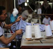 Gaza's tailors stitch together uniforms for the new school year