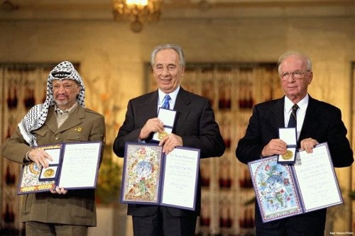 PLO Chairman Yasser Arafat, Israeli Foreign Minister Shimon Peres, Israeli Prime Minister Yitzhak Rabin after the signing of the Oslo Accords in 1993 [Saar Yaacov/Flickr]