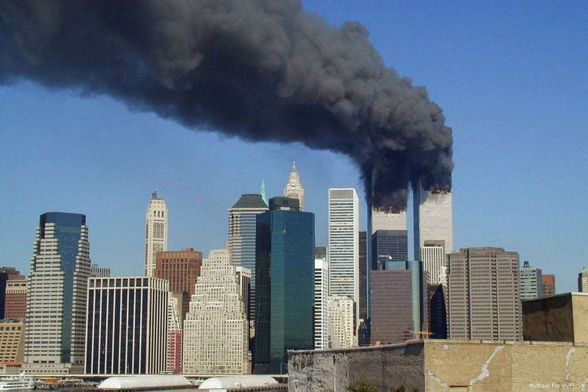 Plumes of smoke can be seen from the World Trade Center towers in New York City during the 9/11 attacks [Michael Foran/Flickr]