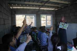 After Israeli forces demolished the school in Bethlehem district of West Bank, the school was re-opened by the Palestinian Ministry of Education following reconstruction work done by activists [Mamoun Wazwaz/Anadolu Agency]