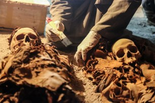 An Egyptian archaeologist restores a wooden tomb of a goldsmith named Amenemhat from the time of Tutankhamu in Luxor, Egypt on 9 September 2017 [Ibrahim Ramadan/Anadolu Agency]