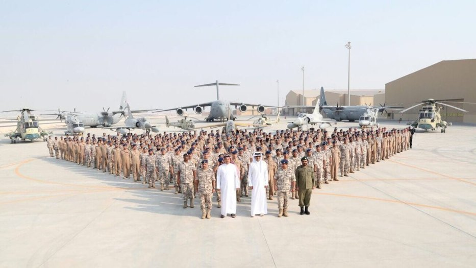 Qatari Sheikh Tamim bin Hamad Al Thani, Minister of State for Defence of Qatar, Khalid bin Mohammad Al Attiyah and Qatari Chief of the Army Mubarak Mohammed Al Khayareen pose for a photo with soldiers as part of their visit to US Combined Air Operations Center of Qatar (CAOC) at Al Udeid Air Base in Doha, Qatar on September 11, 2017 [Qatari Defense Ministry / Handout - Anadolu Agency]