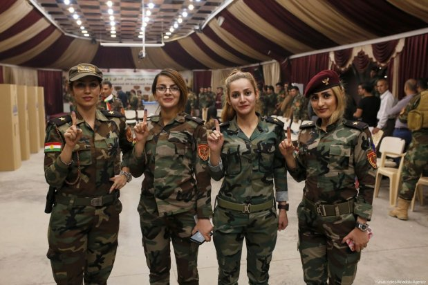 Peshmerga forces cast their ballots in the Kurdish Regional Government (KRG) controversial referendum at a military polling station in Rashkin village of Erbil, Iraq on 25 September 2017. [Yunus Keleş /Anadolu Agency]