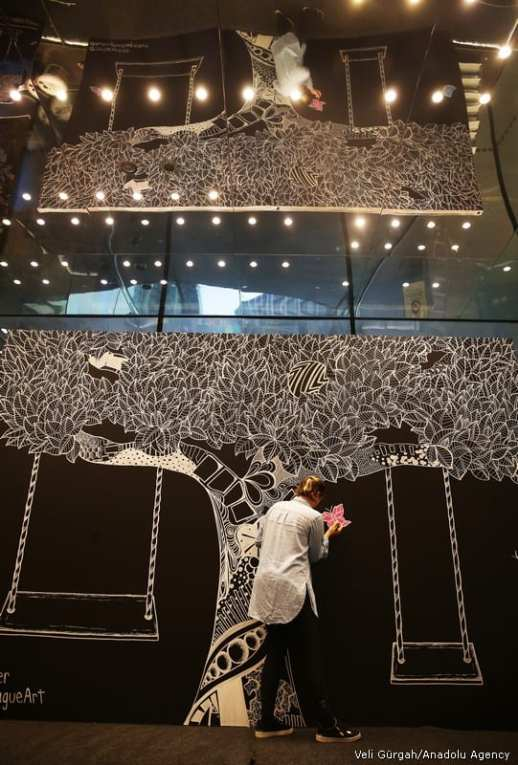 If you have solid roots you'll have a lush foliage 🌳 🌳 🌳 American artist 🎨Kelsey Montague works on a mobile wall at Zorlu Center in Istanbul, Turkey on 27 September, 2017 [Veli GürgahAnadolu Agency]