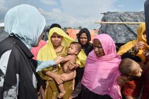Turkey's First Lady, Emine Erdogan, hands out aid to the Rohingya Muslim refugees during a visit to a camp near the Myanmar border