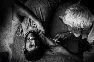 Image of a man taking drugs. There is a crack epidemic which is devastating the poverty-stricken Arab Al-Ahwaz region of Iran [KhouzNews.ir]