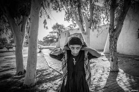 Image of a young boy taking drugs. There is a crack epidemic which is devastating the poverty-stricken Arab Al-Ahwaz region of Iran [KhouzNews.ir]