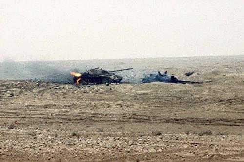Damaged Iraqi battle tanks can be seen near the Kuwaiti border during the First Gulf War [SSgt. Reeve, US Army/Wikipedia]