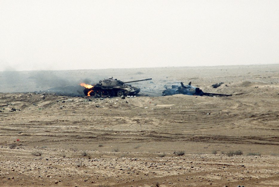 Damaged Iraqi battle tanks can be seen near the Kuwaiti border during the First Gulf War [SSgt. Reeve, US Army/Wikipedia]