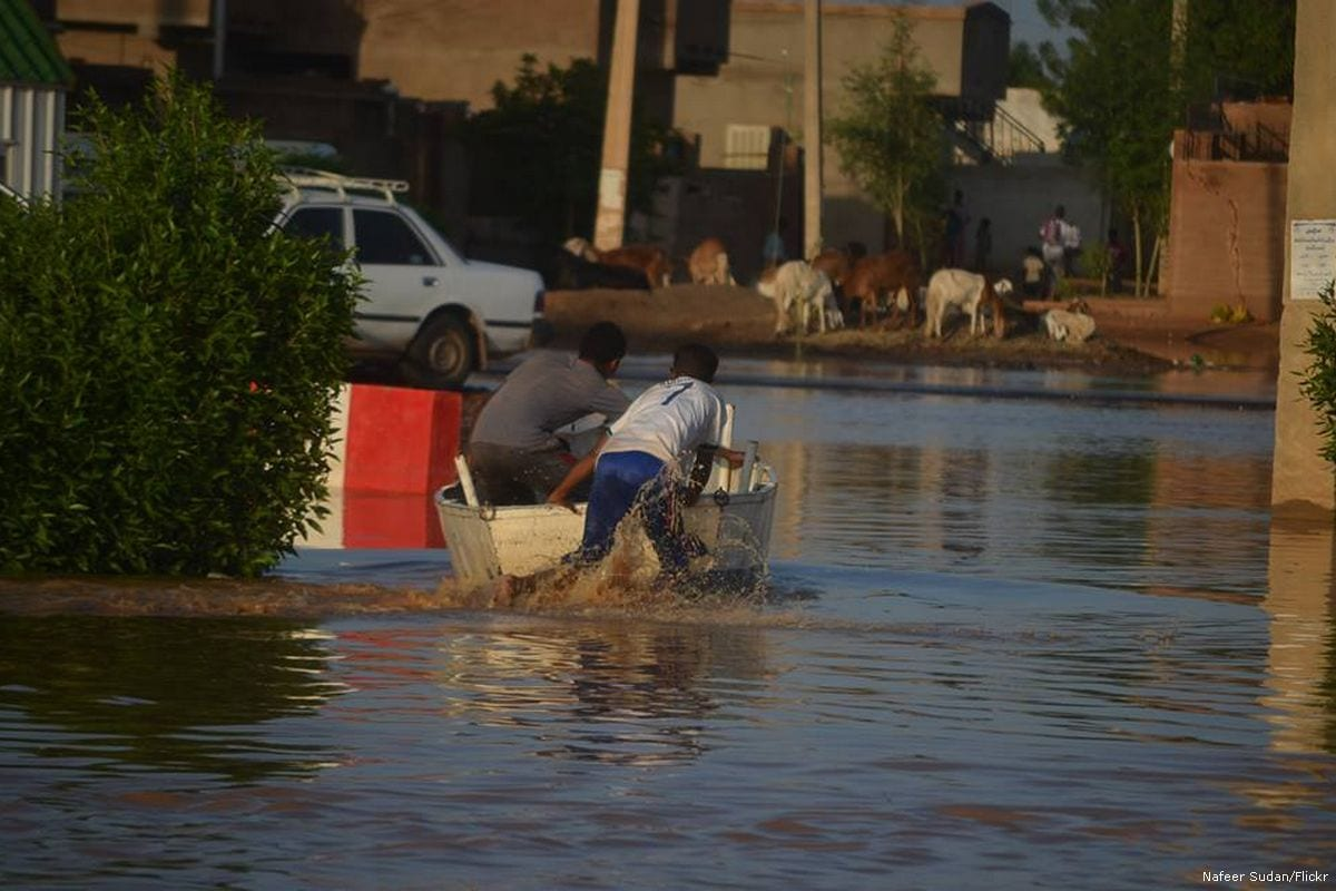 Sudanese boys can be seen on a boat during a flood in Sudan [Nafeer Sudan/Flickr]