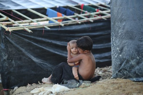 Rohingya refugee kid is seen at a makeshift refugee camp in Cox's Bazar, Bangladesh on September 25, 2017. According to UNICEF, about 2,30,000 refugee child entered in Bangladesh which is 60 percent of Rohingya refugee that have entered in last month. [zakir hossain chowdhury - Anadolu Agency]