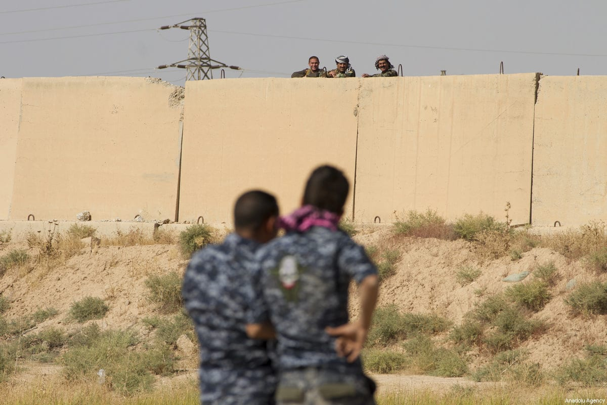 Iraqi security forces inspect Peshmerga site in Kirkuk, Iraq on October 14, 2017. Iraqi security forces continue to deploy troops at southern Kirkuk as tension between Hashd al-Shaabi fighters and Peshmerga increases [ Hassan Ghaedi / Anadolu Agency]